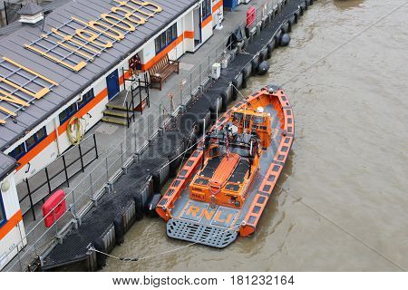London, October 2016. An orange and grey lifeboat operated by the Royal National Lifeboat Institution is on the River Thames in London