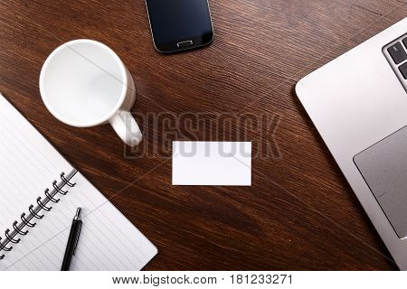 Blank business card design mockup. Visiting card, smartphone and laptop. Business branding template. White cup or mug.