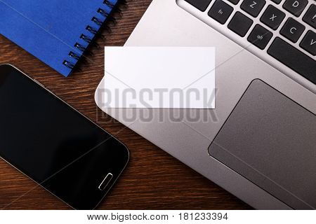 Blank business card design mockup. Visiting card, smartphone and laptop. Business branding template.