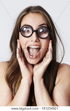 Geek girl excited in large spectacles portrait
