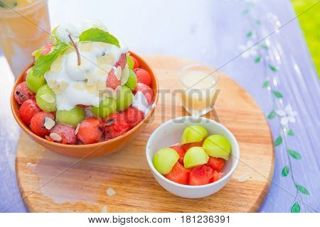 Bingsu dessert Summer season sweeten Asian lifestyle menu eat cooling sweet iced with delight delicious fruit topping and blended Peach smoothie drink Korean style Shaved Ice dessert.