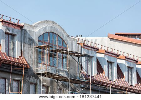 Housing Development's Construction Site. Scaffolding On Facade Of House.