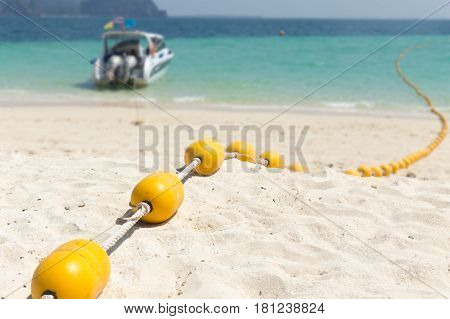 Sea beach with yellow buoys Safety Swimming zone separator Thailand ocean travel background.