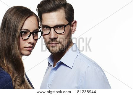 Couple wearing eyeglasses white background studio shot