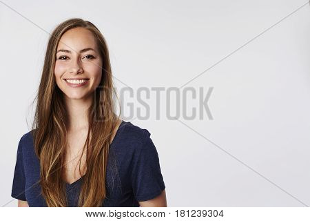 Smiling beautiful woman in white studio studio shot