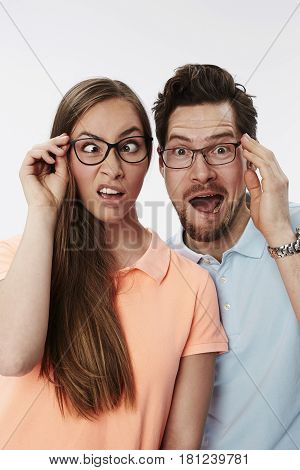Crazy couple pulling faces portrait studio shot