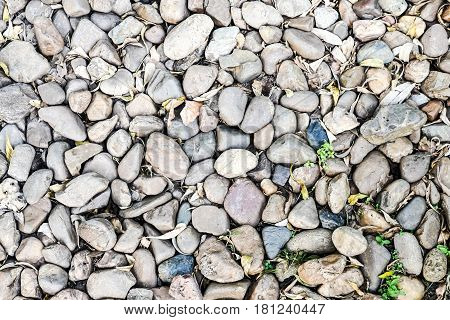 Stone background. Pile of stones on the ground.