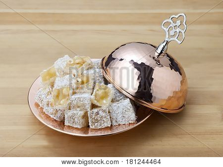 traditional turkish delight plate on wooden table