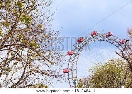 Prater Ferris Wheel, icon of Vienna, Austria among spring green trees