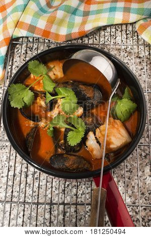 mussels cod and tomato soup in pot