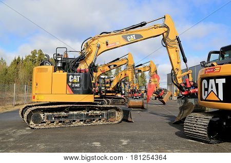 LIETO FINLAND - MARCH 25 2017: 314E L CR excavator along with other Cat construction equipment seen at the public event of Konekaupan Villi Lansi Machinery Sales.