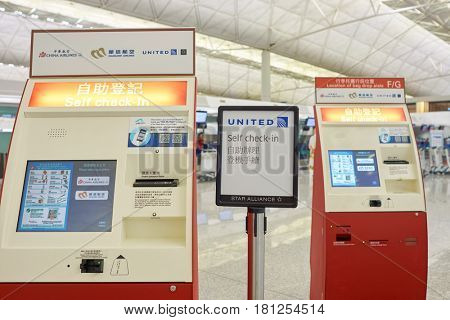 HONG KONG - CIRCA NOVEMBER, 2016: self check-in kiosks at Hong Kong International Airport. It is the main airport in Hong Kong. The airport is located on the island of Chek Lap Kok