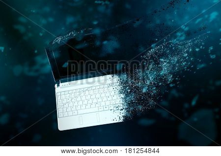 The old laptop is disintegrating in space. Conception of passage of time and obsolete technology