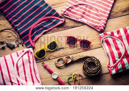 clothing for women placed on a wooden floor.