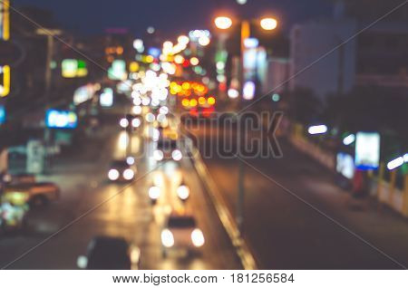 Night road in the city of lights cars traffic on street