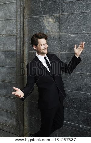 Happy go lucky businessman in black smiling