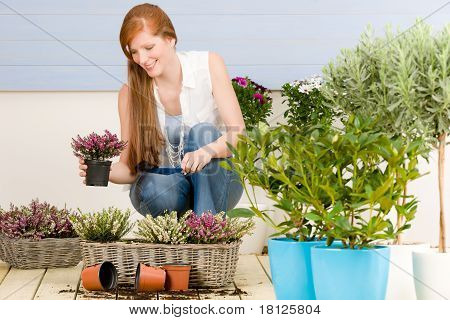 Summer Garden Terrace Redhead Woman With Flowers