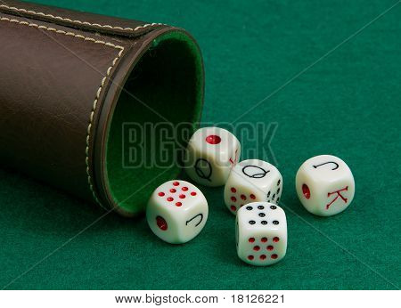 Poker Dice On A Green Background
