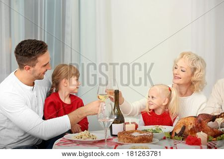 Happy family having Thanksgiving dinner in living room