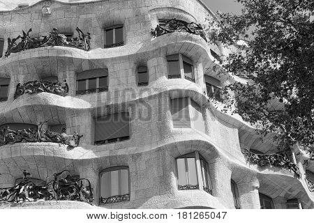 BARCELONA, SPAIN - JULY 12, 2016: Barcelona (Catalunya Spain): house Mila or Pedrera famous building by Gaudi along the Paseig de Gracia. Black and white