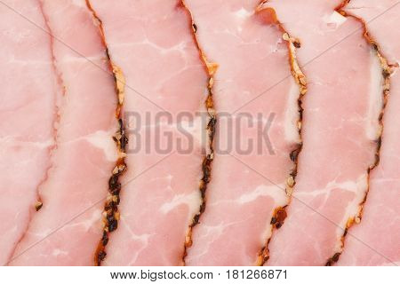 top view closeup of slices of smoked pork loin ham arranged in a stack