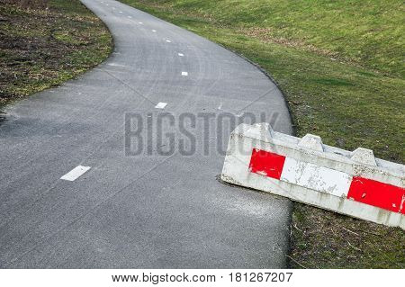 Concrete Road Block With Red White Warning Sign