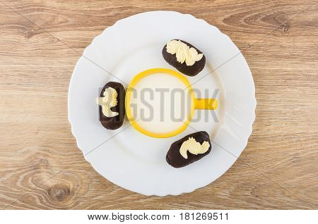 Cup Of Milk, Chocolate Biscuit Cakes With Buttercream In Dish