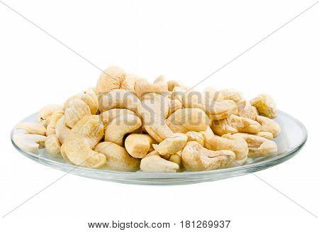 Saucer With A Row Cashew Nuts Isolated On White Background