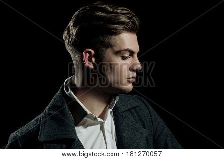 Handsome Man With Stylish Blond Hair Posing With Serious Face