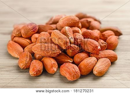 Heap Of Raw Peanuts On The Wooden Background