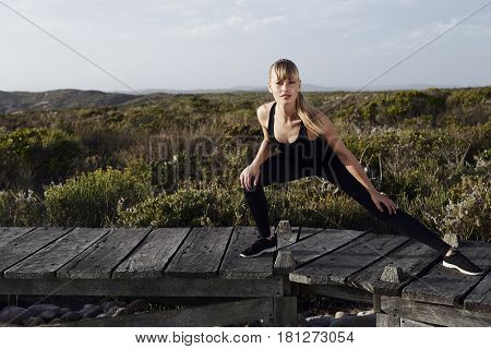 Portrait of blond lithe young athlete outdoors