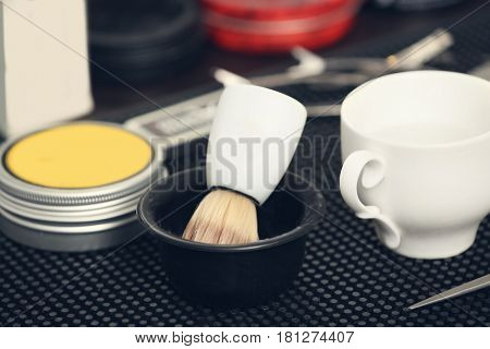 Shaving brush and other tools in barbershop