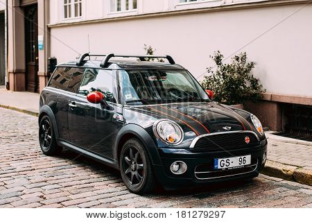 Riga, Latvia - July 2, 2016: Black Color Car With Stripes Mini Cooper Clubman Parked On Street In Old Part European Town.