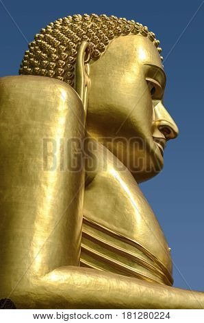 A gold covered statue of Buddha is the central figure at the Golden Temple in the Dambulla temple complex near Kandalarma in Sri Lanka.
