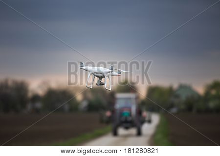 Drone Flying In Front Of Tractor