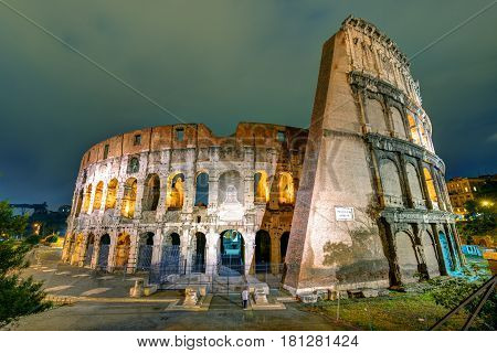 Colosseum (Coliseum) at night in Rome, Italy. The Colosseum is an important monument of antiquity and is one of the main tourist attractions of Rome.