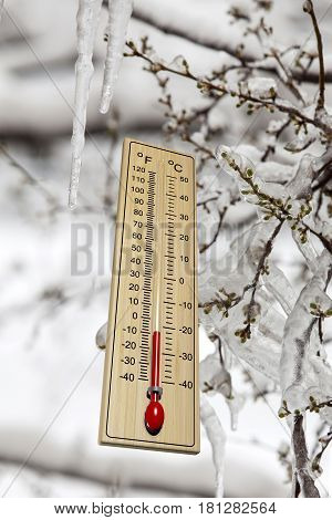 Thermometer on snowy winter background close up
