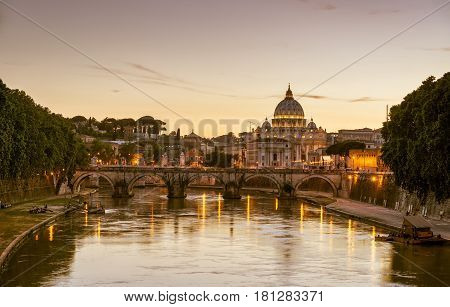 Night view of Rome. Ponte Sant`Angelo (Bridge of Holy Angel) and Basilica San Pietro (Saint Peter's cathedral). Rome cityscape, Italy.