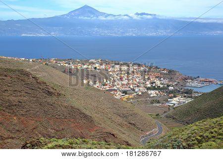 SAN SEBASTIAN DE LA GOMERA, LA GOMERA, SPAIN: General view of San Sebastian de la Gomera with Teide Volcano (in Tenerife Island) in the background