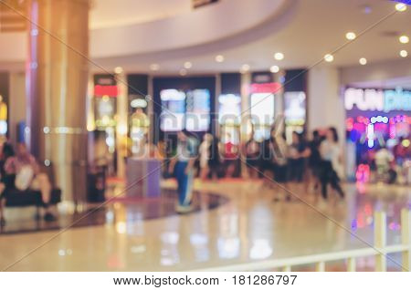 blurred image of shopping mall and people for background