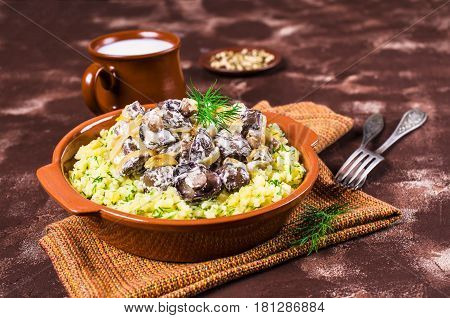Stewed mushrooms in white sauce and mashed potatoes. Selective focus.