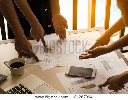 business team analysis with financial graph at office workplacemeeting times.