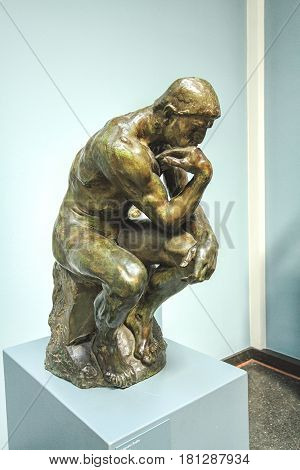 COPENHAGEN DENMARK - JUNE 15: Rodin's The Thinker is among the most recognized works in all of sculpture collected by Carl Jacobsen in NY Carlsberg Glyptotek in 2012