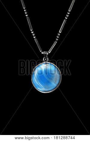 Blue aquamarine medallion on a chain isolated over black