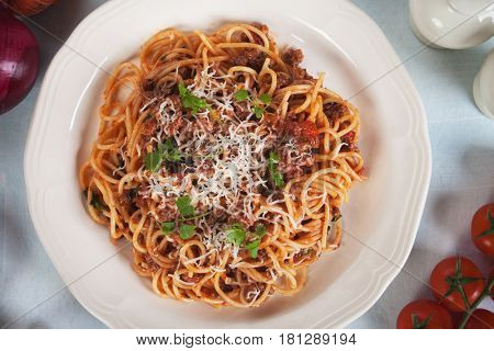 Italian spaghetti in bolognese sauce with ground beef and tomato