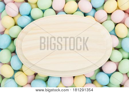 Old fashion Easter background Retro Easter eggs candy with blank wood plaque for your message