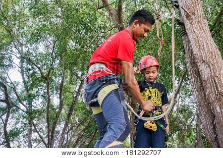 Labuan,Malaysia-Feb 11,2017:Happy kid ready to play the flying fox in Labuan,Malaysia.There will be more zipline in Malaysia,especially when there have so much natural resources & rainforest.