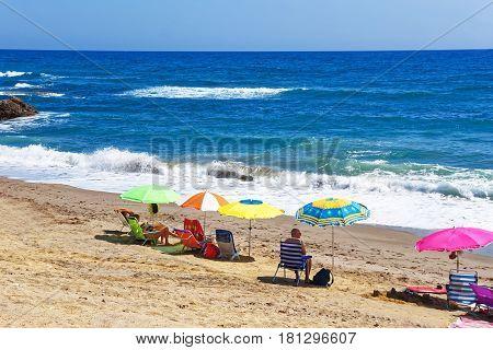 Marbella, Spain - August 20, 2011: People sunbathing on the beach at the Mediterranean Sea in Marbella Andalusia Spain