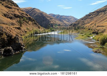 Grande Ronde River Meandering Through Rocky Hillsides and Cottonwood Trees eastern Oregon USA