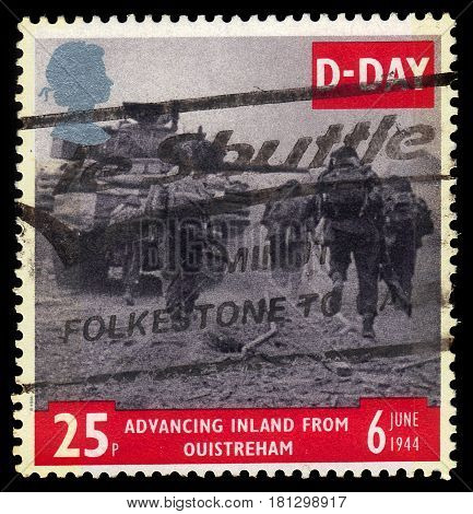 UNITED KINGDOM - CIRCA 1994: A stamp printed in Great Britain shows tank and infantry advancing from Ouistreham, 50th anniversary of D-Day, circa 1994